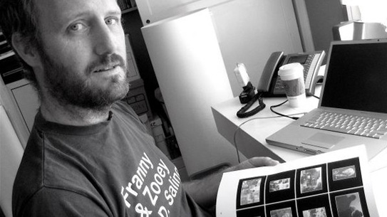 Mike Mills looking over some layouts from his new book