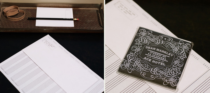 Ace stationary with blank music sheets and Dean Markley guitar strings for the guitar in the room