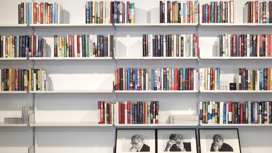 Vitsœ's 606 Universal Shelving System with portraits of Dieter Rams