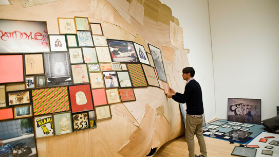 Barry McGee installing his piece at SFMoMA, part of the museum's 75th anniversary show