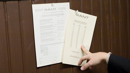 Original order sheets from Gant, pinned to the wall in the fitting room.