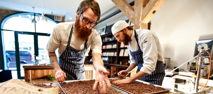 Rick and Michael sort through the cacao beans