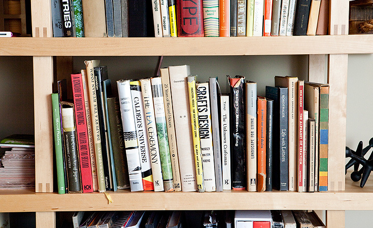 A collection of Mid-Century Modern books ranging from type and design to homes and gardens.