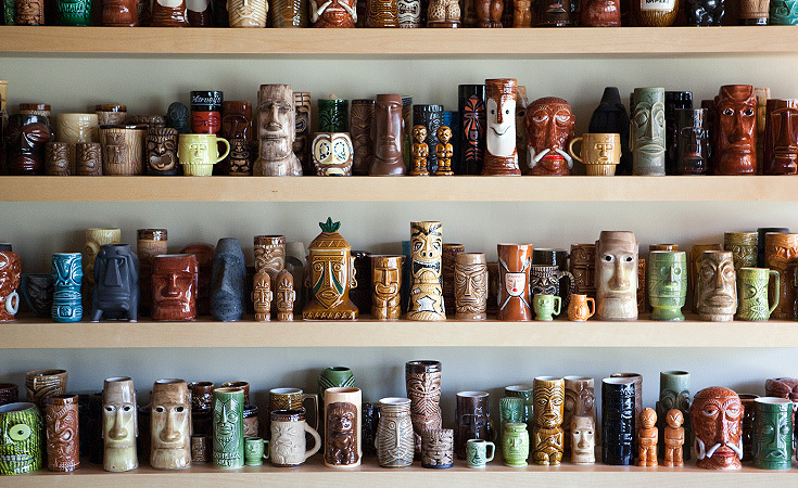 An artistic obsession, Andy's tiki mug collection on display.