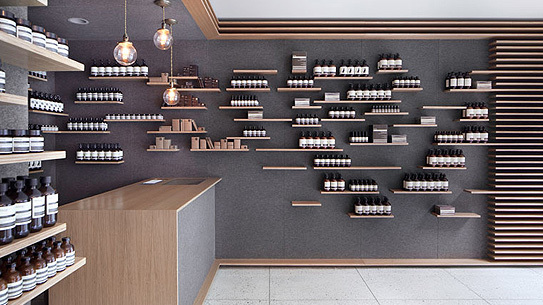 The Aesop University Place store uses industrial wool felt for the walls and oak plywood for the shelves.