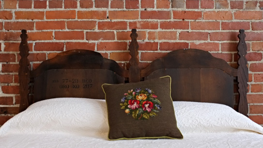 The inn is furnished with vintage finds throughout the flat including this unique headboard in one of the bedrooms.