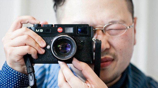 Takashi Tateno, founder and owner of Workers, with his Leica M9.