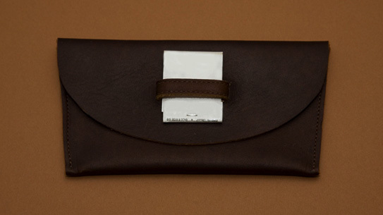 A tobacco pouch with strap hand made by Absolute Classic Masterpieces.