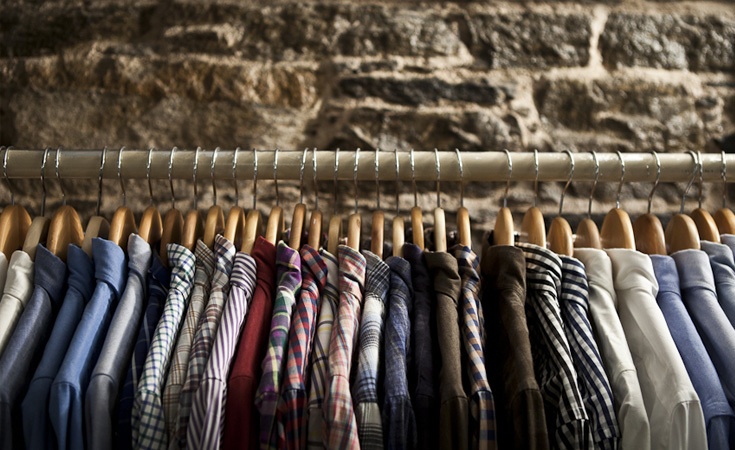 A rack of shirts including Individualized an American shirt maker based in Perth Amboy, New Jersey.