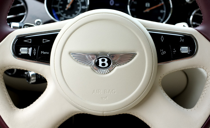 Sumptuous hand stitched leather steering wheel.