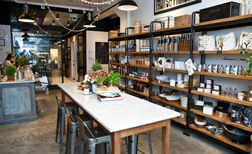 The shop greets visitors to the first floor at Haven's Kitchen where a communal table sits in the middle encouraging interaction amongst its patrons.