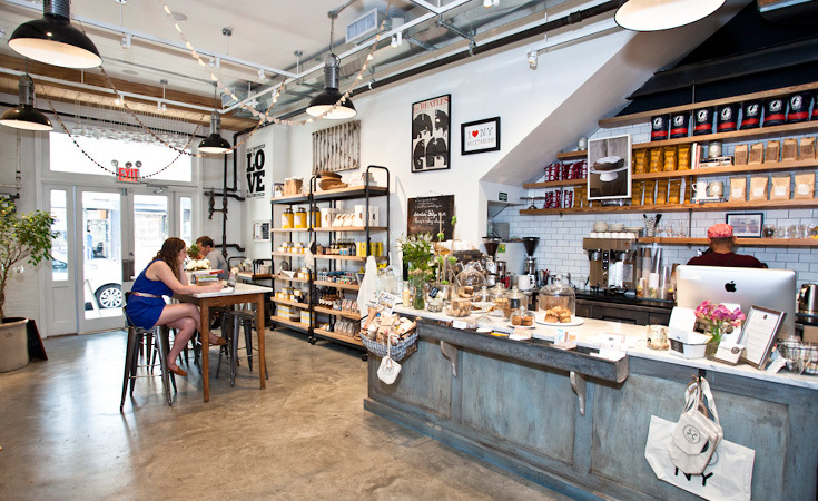 The shop includes a pastry and coffee counter serving La Colombe coffee.