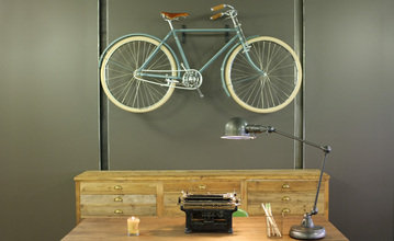 A prototype Shinola bike sits behind the front desk in the reception area.
