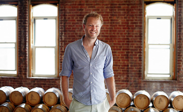 Colin Spoelman, co-founder of Kings County Distillery, with his inventory of aging whiskey.