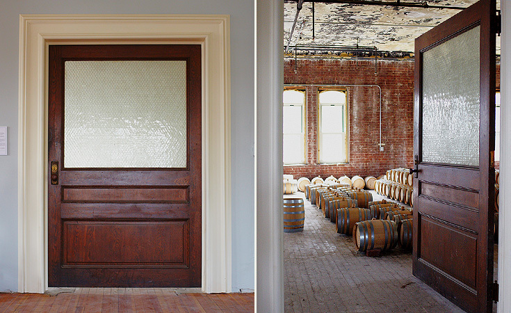 Behind the massive door is a room filled with barrels of aging whiskey.