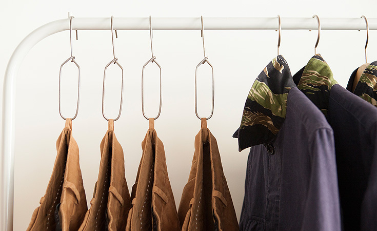 Details of the new display system. The Gio pant and Charlie jacket hang from specially designed racks.