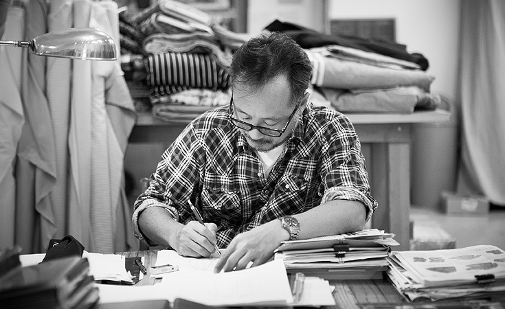Suzuki sketching in his studio.