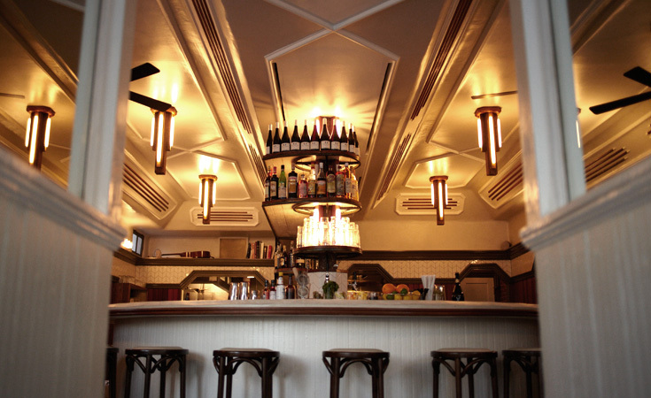 The narrow entrance gives way to the bar that is the spectacular centerpiece of the restaurant's design.