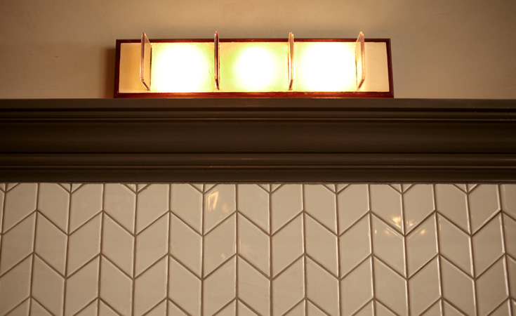 Further details in the tile work and lighting fixtures.