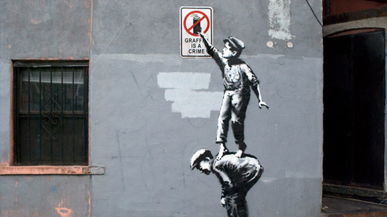 Banksy's first piece in Chinatown during his month long residency on the streets of NYC.