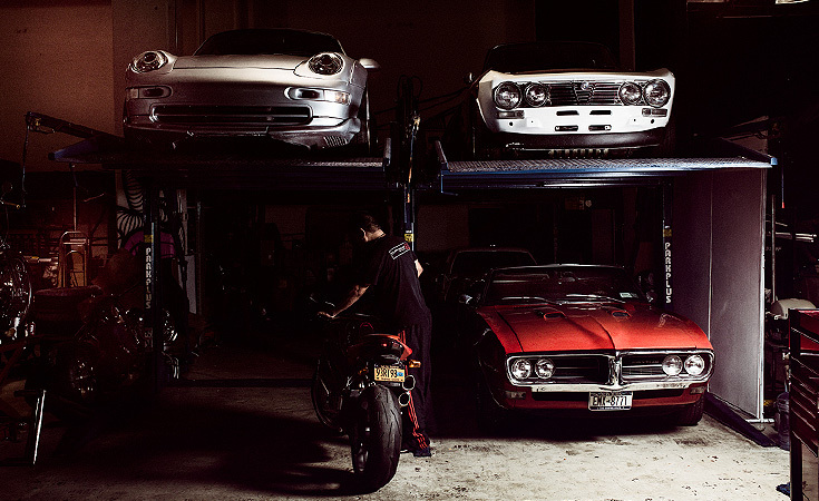 Cars in the shop (clockwise from top left)–1996 GT2 variant Porsche 911, 1975 Alfa Romeo GTV, 1969 Pontiac Firebird convertible, and a MV Agusta Brutale.