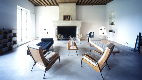 Massimiliano and Doriana fuksas's home furnished with original Jean Prouve chairs.