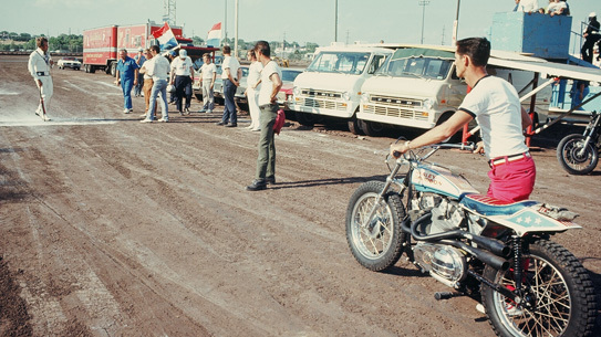 Evel Knievel walks towards his famed Harley Davidson XR 750